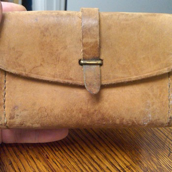Odd hand-made leather pouch