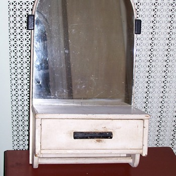 A washstand mirror with drawer and towel bar