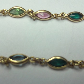 18K yellow gold different gemstones bracelet