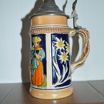 German stein with edelweiss and drinking scene