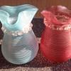 Two threaded spill vases