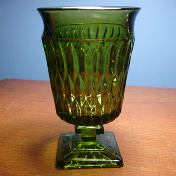 Green  glass covered tall footed candy dish   no maker marks that I can see