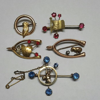A small selection of gold brooches