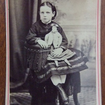 Enameled CDV of girl with a doll