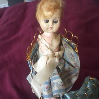 an old doll my aunt gave me with a sleigh