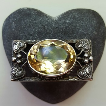 Shipton or German Arts and Crafts inspired citrine silver brooch.
