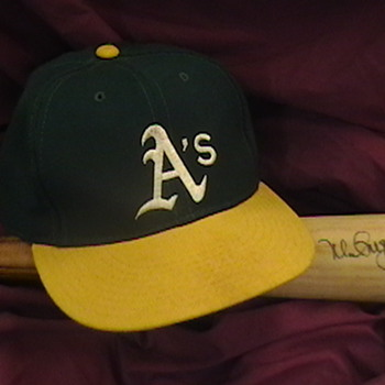 Autographed Mark McGwire 1996 Game Used Rawlings Bat and Cap