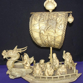 Asian ship with Buddhas or 7 Lucky Gods.  Maybe Celluloid?