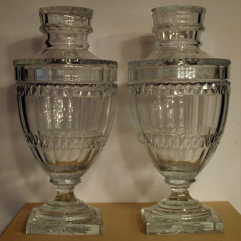 Pair of covered URN-shaped cut crystal jars on square bases