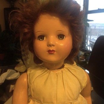 A vintage mechanical wind up doll