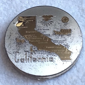 Antique silver powder compact with gold California overlay