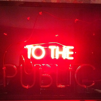 Neon sign ''to the public''.