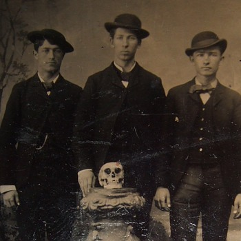 Tintype of Young men with a SKULL displayed