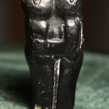 Tiny Black Figurine of a Man and a Woman