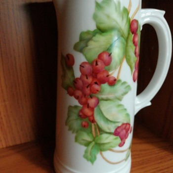 Handpainted vase with berries.