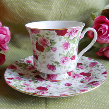 Porcelain tea cup, and saucer set.