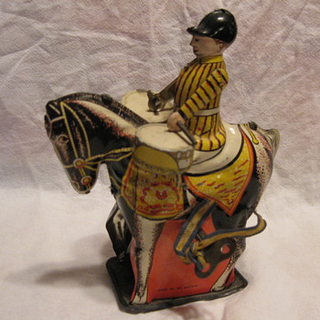 Tin or Metal drummer on a wind-up horse with key - Toys