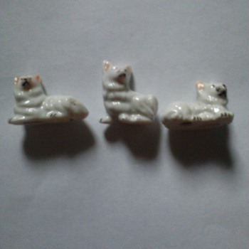 three little made in Japan dogs