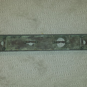Brass (?) level