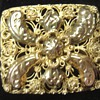A little golden peasant brooch
