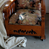 old oak chair with small metal wheels