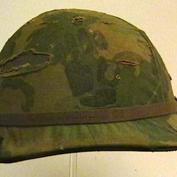 U.S. Army M-1 Helmet with Cover and Two NVA Flags - Military and Wartime