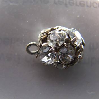"Found this mystery ""diamond ball"" or charm... anyone know what it is?"