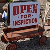 Old Sandwichboard - OPEN FOR INSPECTION and a Western Wizard Red Wagon