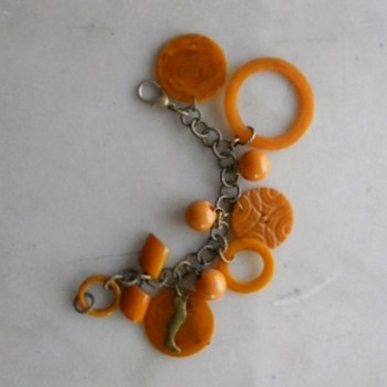 Vintage bakelite bits  get new life as a charm bracelet - Costume Jewelry