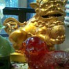 Gold pair of foo dogs