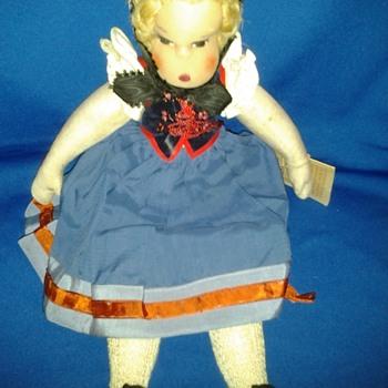 Identifying These Dolls