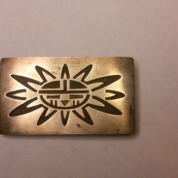 Sterling silver belt buckle with sun engraving
