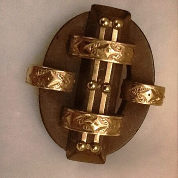Rare Vulcanite Brooch wrapped with decorated 14K gold bands.
