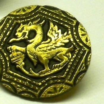 A dragon, or griffin, or some other heraldry?