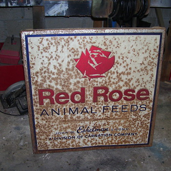 Two old feed signs