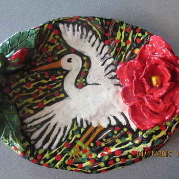 Pottery plate with stork and flowers
