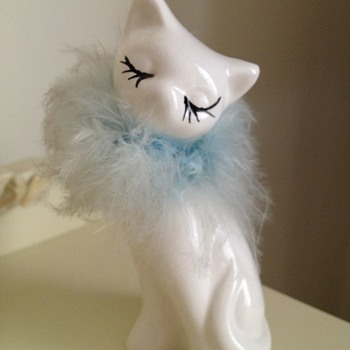 Fur trimmed cat figurine
