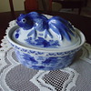 BLUE AND WHITE BOWL WITH FISH ON COVER.