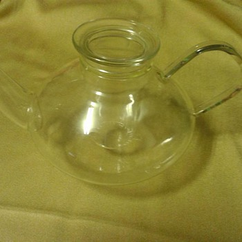 Glass teapot...antique...value please?