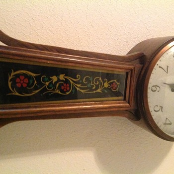 Closer pics of clock. Front of clock. Picture has the writing in the lower right hand corner.