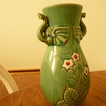 Vase with elephant heads, flowers and greenery - Art Pottery