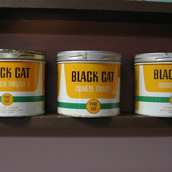 Black Cat tins
