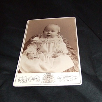 Cabinet card of child holding a nail c. 1880 - Photographs
