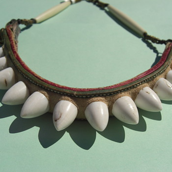 Bone or tooth item made into a necklace - Folk Art