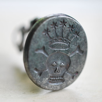 skull and crossbones under a crown antique fob seal