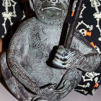 Metal monkey candle holder