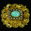 A Georgian to Regency Period Gold Brooch - later set with a Coober Pedy Crystal Opal, circa 1935