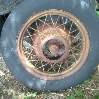I need information on these old spoke wire wheels we found in a pile of old tires - Classic Cars