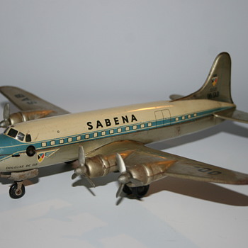 Arnold Douglas DC6 Sabena tin wind up toy airplane
