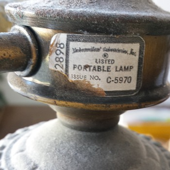 Vintage lamp- need help reading manufacturer stamp!
